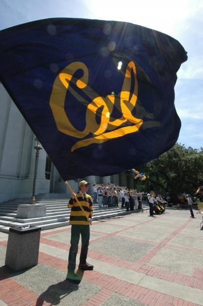 Student waving Cal flag